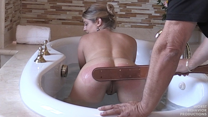 Bath Strapping - She lowers her bottom in the water every swat